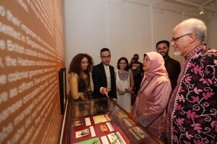 President Halimah Yacob and husband Mohamed Abdullah Alhabshee viewing items on display at the Entitled Here And Now: Arabs In Singapore exhibition, on April 13, 2019.
