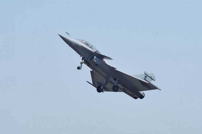 A Rafale fighter jet performing a manoeuvre during a flying display at the Yelahanka Air Force station in Bangalore, on Feb 20, 2019.