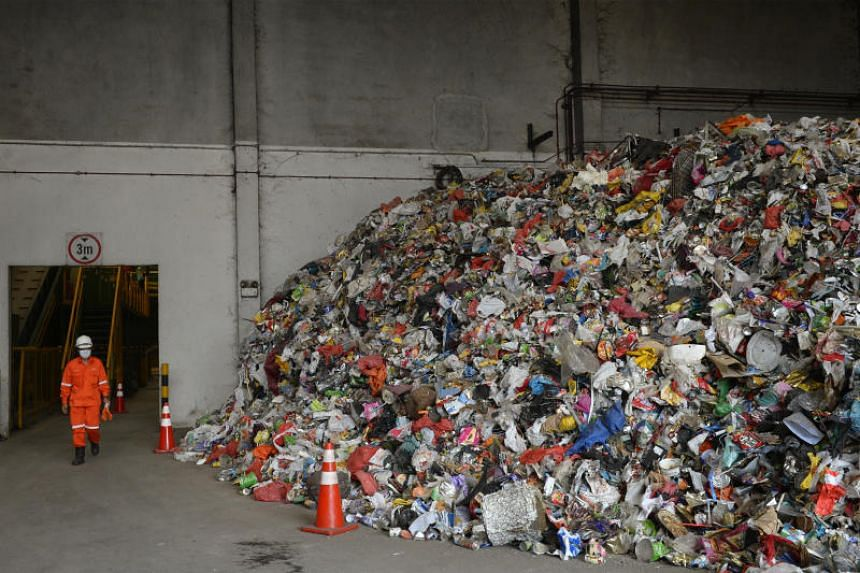 Singapore's yearly waste weighs the same as 530,000 double-decker buses, and that's not sustainable says Masagos