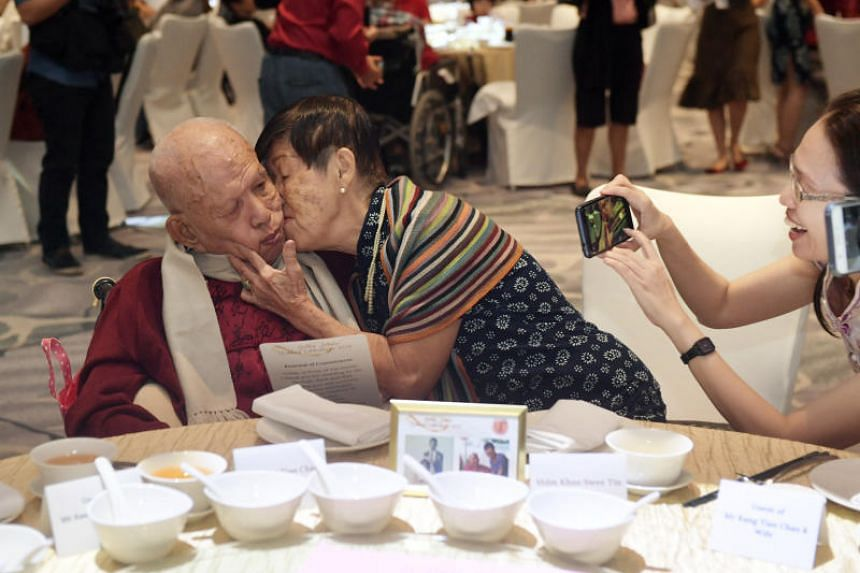 Mr Kang Tian Chan receiving a kiss from his wife of 57 years, Mdm Khoo Swee Tin.