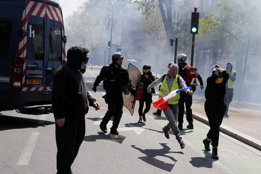 Protestors from the Yellow Vests movement clash with French riot Police during a demonstration in Toulouse, France, on April 13, 2019.