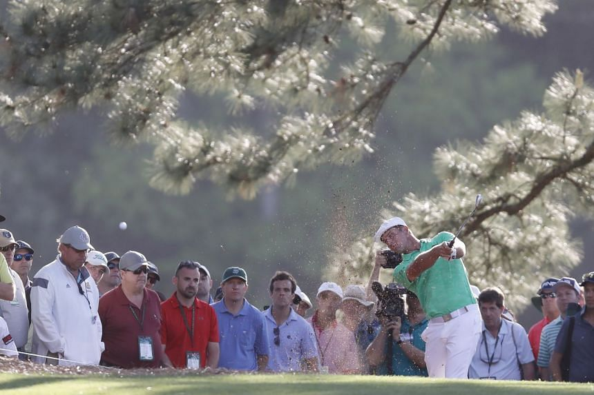 American Bryson DeChambeau hitting from the pine straw on the 17th hole in the first round of the Masters Tournament at Augusta, Georgia on Thursday. He had six birdies in his back nine and eight overall.