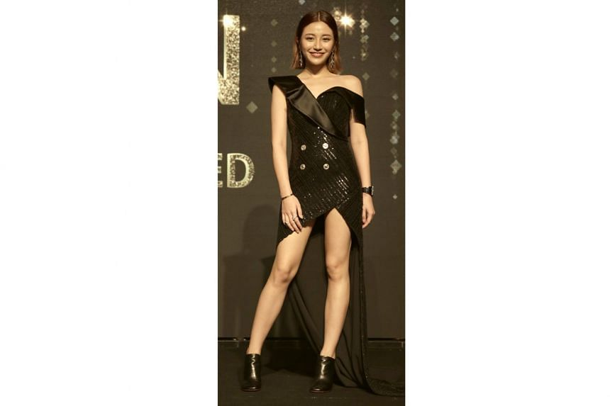 Socialite Calista Cuaca, daughter of socialite Jamie Chua, wearing an outfit by Diana Couture by Diana Putri, shoes from Vetements and watch from Richard Mille.