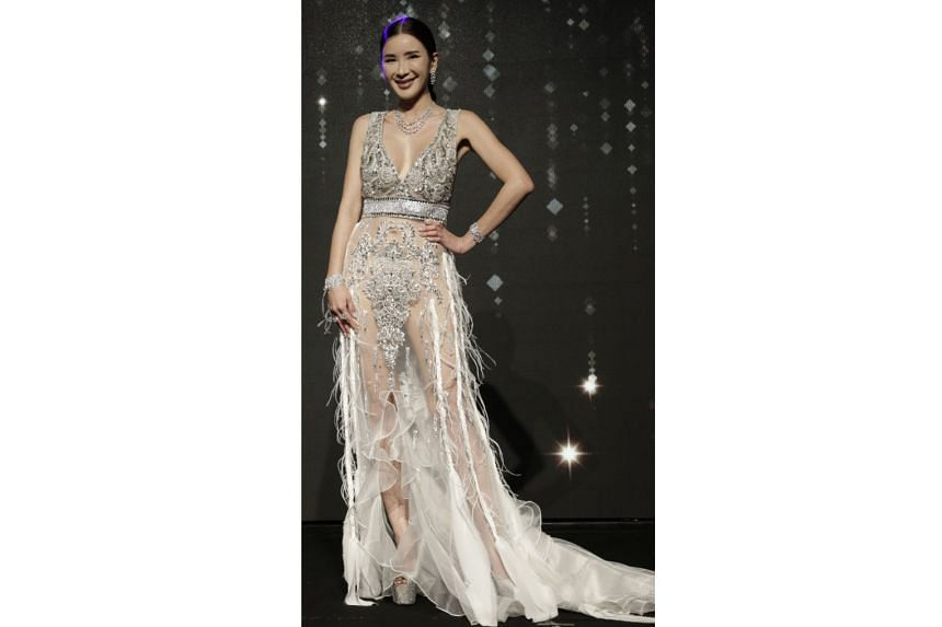 Jamie Chua wearing a custom-made gown from Farah Angsana Haute Couture, jewellery from The Canary Diamond and shoes from Giuseppe Zanotti.
