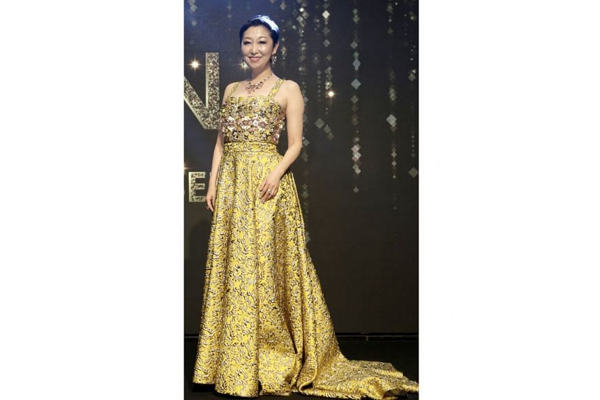 Housewife Jin Lu wearing a special edition Prada bespoke dress, with jewellery from Bulgari and shoes from Jimmy Choo.