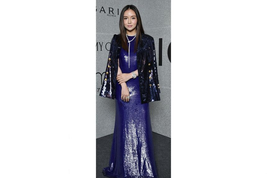 Socialite Kim Lim in a blue sequin Ralph Lauren gown, watch from Patek Philippe and jewellery from Bulgari.