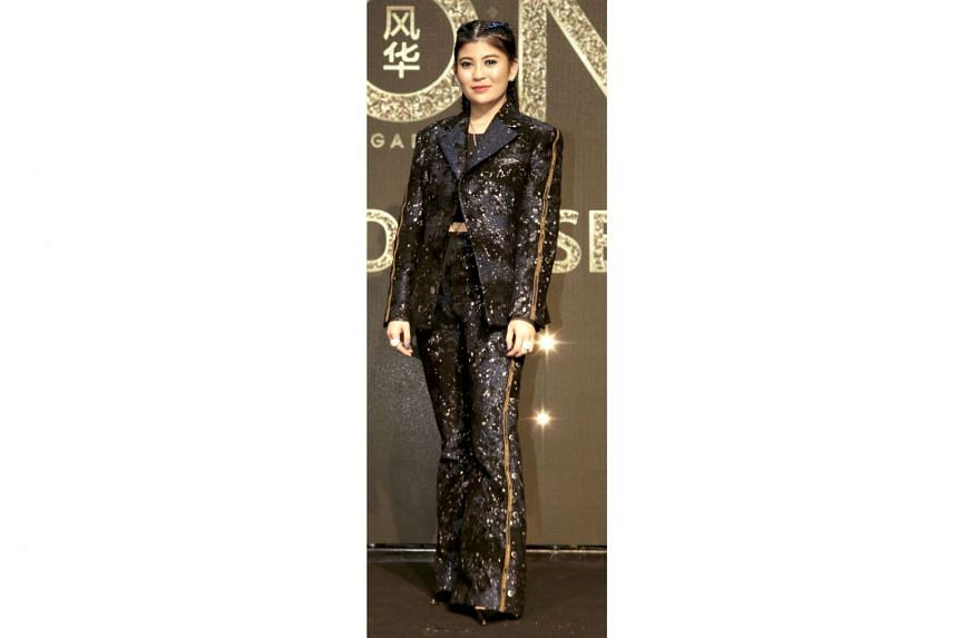 Jeweller Sabrina Ho wearing a suit from Christian Dada and shoes from Christian Louboutin.