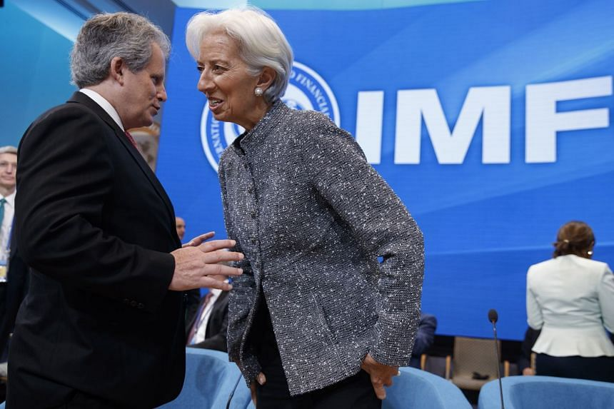 IMF chief Christine Lagarde (right) talks with IMF first deputy managing director David Lipton prior to the IMFC meeting.