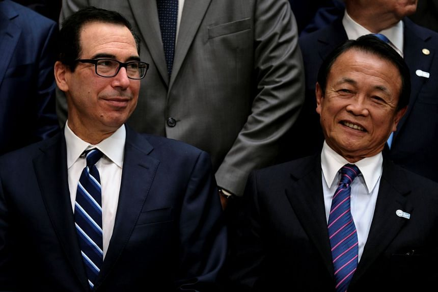 Steven Mnuchin (left) and Japanese Finance Minister Taro Aso at the IMF and World Bank's Annual Spring Meetings.