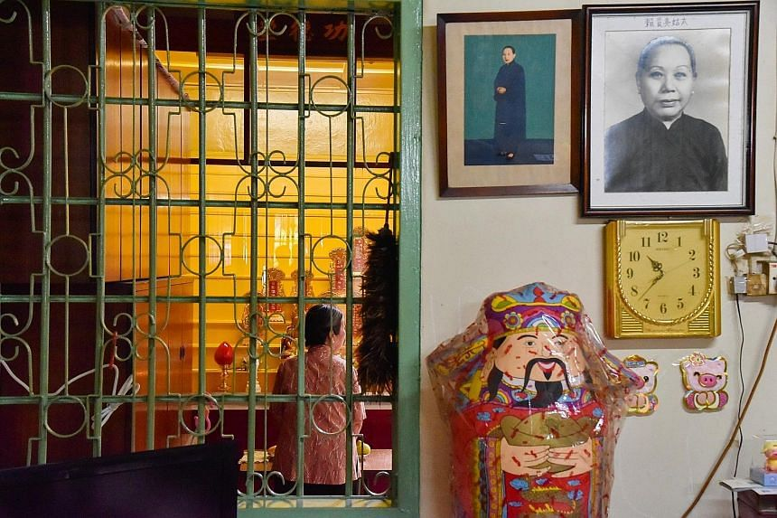 Ritual costumes donated by the defunct Vegetarian Hall of the Blessed Lotus to Dr Hue Guan Thye, who hopes to set up a museum in homage to vegetarian halls.