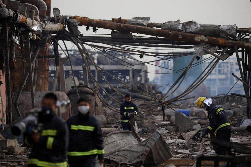 Firefighters work on the site following an explosion at a pesticide plant owned by Tianjiayi Chemical, in Jiangsu, China, on March 22, 2019.