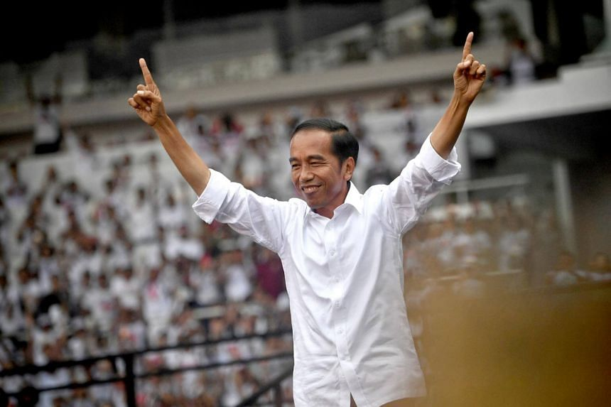 While incumbent Joko Widodo (above) commanded a strong lead for much of the long campaign, the final stretch has thrown up the increasing chance of his opponent, Mr Prabowo Subianto, pulling off an upset.