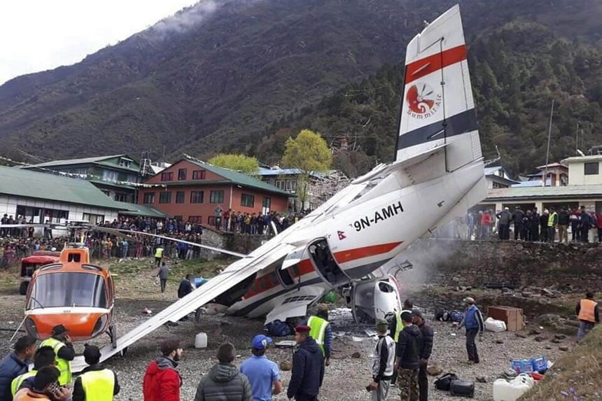 The crash site after the collision of a domestic Summit Air aircraft and a helicopter at Lukla Airport in Nepal, on April 14, 2019.
