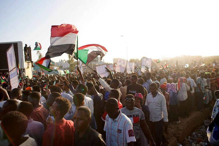 People chant slogans during a protest outside of the Military headquarters in Khartoum, Sudan, on April 13, 2019.