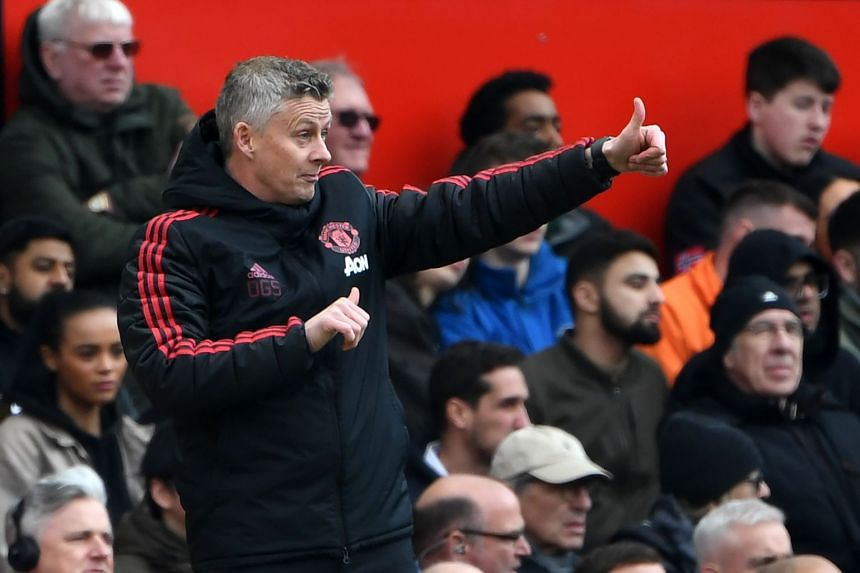 Manchester United's Norwegian manager Ole Gunnar Solskjaer gestures during the match.