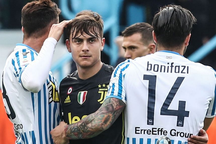 Juventus' Paulo Dybala (centre) embraces SPAL's Kevin Bonifazi (right) at the end of the match.