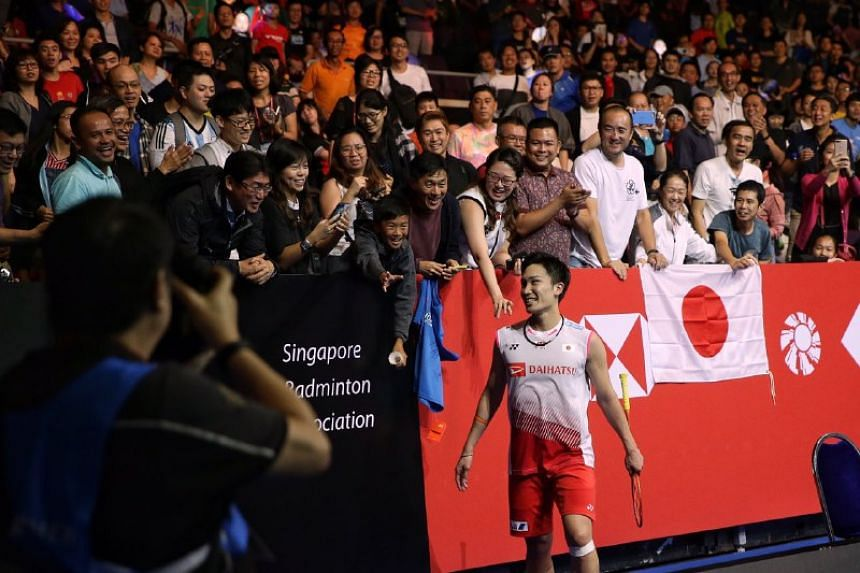Kento Momota beat Anthony Ginting (not pictured) 10-21, 21-19, 21-13 to win the Singapore Badminton Open men's singles title on April 14, 2019.