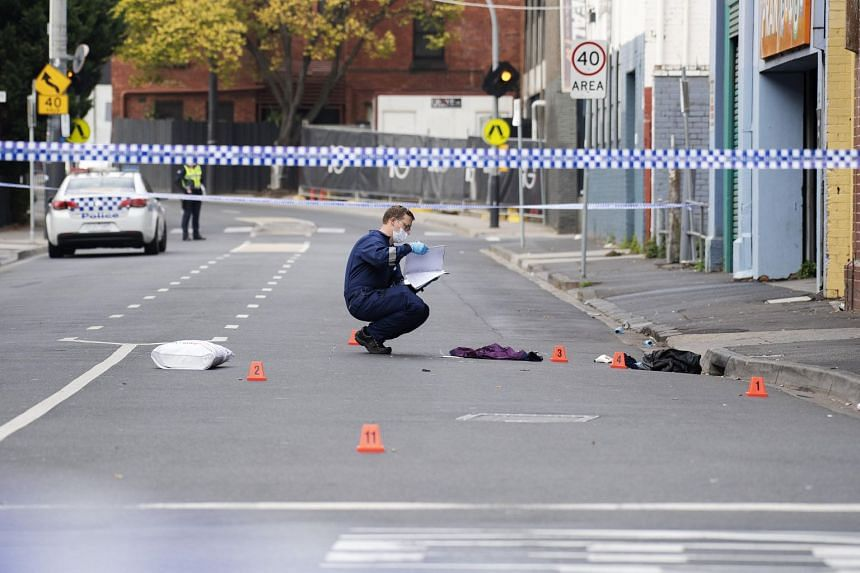 A Victoria Police personnel works at the scene of a multiple shooting outside Love Machine nightclub in Prahran, Melbourne, on April 14, 2019.
