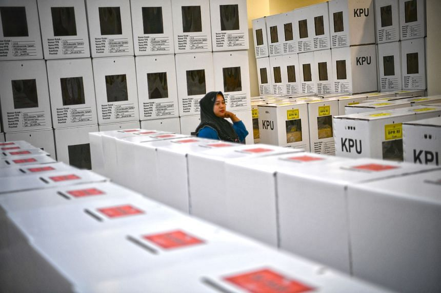 An official at a storage area where ballot boxes and voting materials are prepared for the upcoming elections, in Pademangan, Jakarta, last Thursday. There has been an increasing sense on the ground that the final outcome may lie in the hands of wild