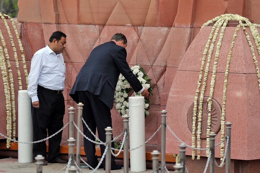 British High Commissioner to India Dominic Asquith laying a wreath yesterday to pay respects to the hundreds of unarmed men, women and children who were gunned down by colonial troops in the northern Indian city of Amritsar on April 13, 1919. British