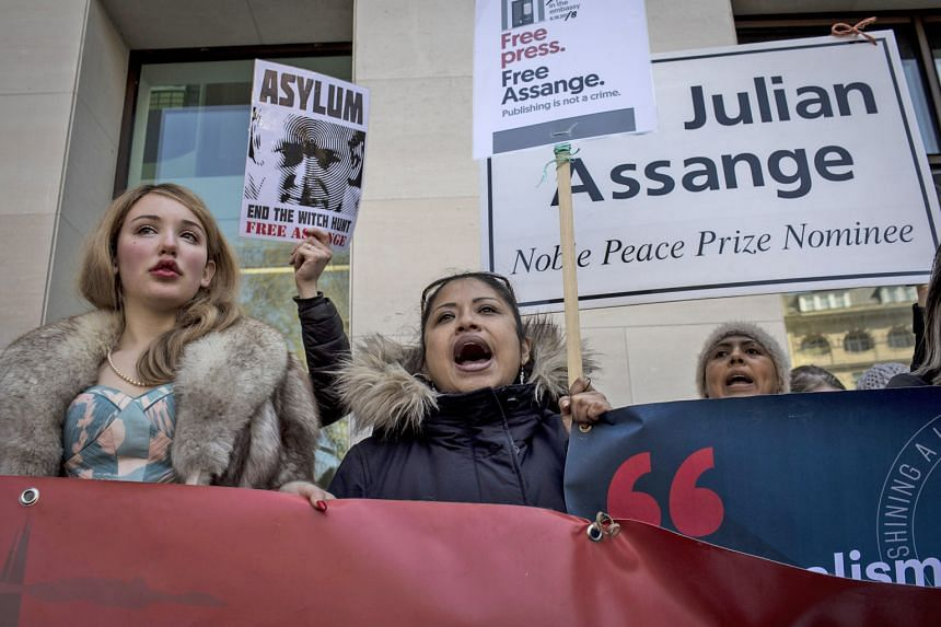 Ecuadorean President Lenin Moreno (above) has said repeatedly that WikiLeaks founder Julian Assange (left) should not be in his country's embassy in London forever. PHOTO:S AGENCE FRANCE-PRESSE, REUTERS Supporters of WikiLeaks founder Julian Assange