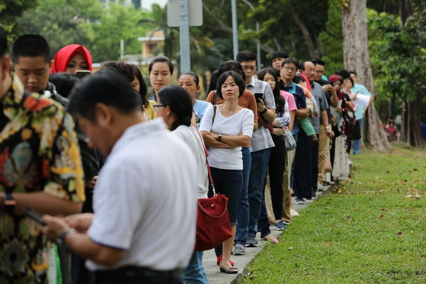 Voters queue at the Indonesian embassy in Chatsworth Road to cast their early vote on April 14, 2019.
