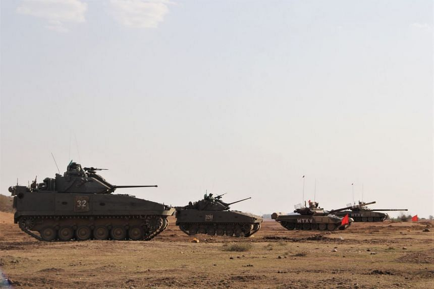 The Singapore Army's infantry fighting vehicles and Indian Army's main battle tanks during the integrated live firing at Exercise Bold Kurukshetra.