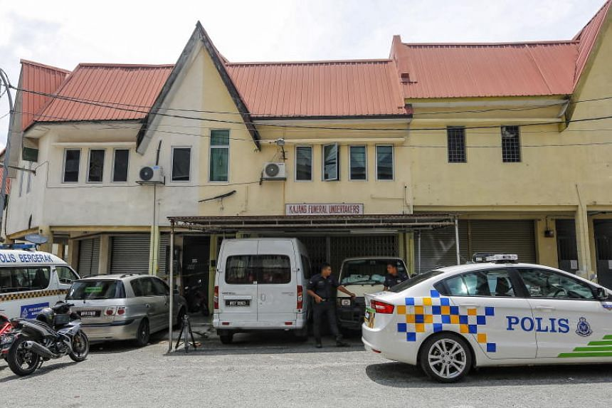 Malaysian police guard at the building where ballots cast in favour of Indonesian President Joko Widodo were found in Kajang, Malaysia, on April 12, 2019.