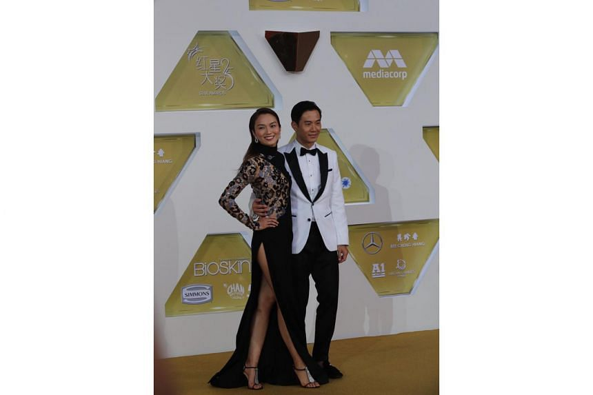 Local actress Joanne Peh and her actor husband Qi Yuwu arrive for the Star Awards ceremony on April 14, 2019.
