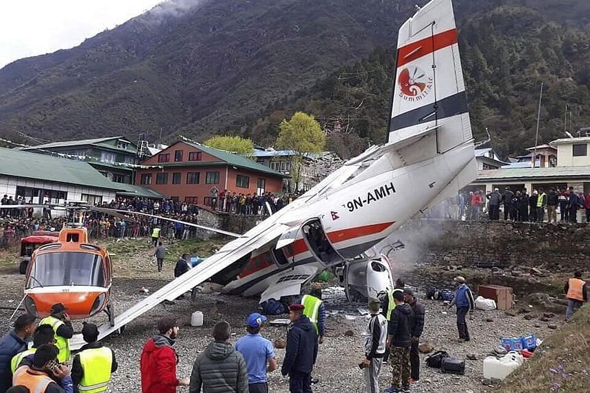 The crash site of a domestic Summit Air aircraft and two helicopters at Lukla Airport in Nepal yesterday. The airport is reputed to be one of the most difficult in the world for landings and take-offs.
