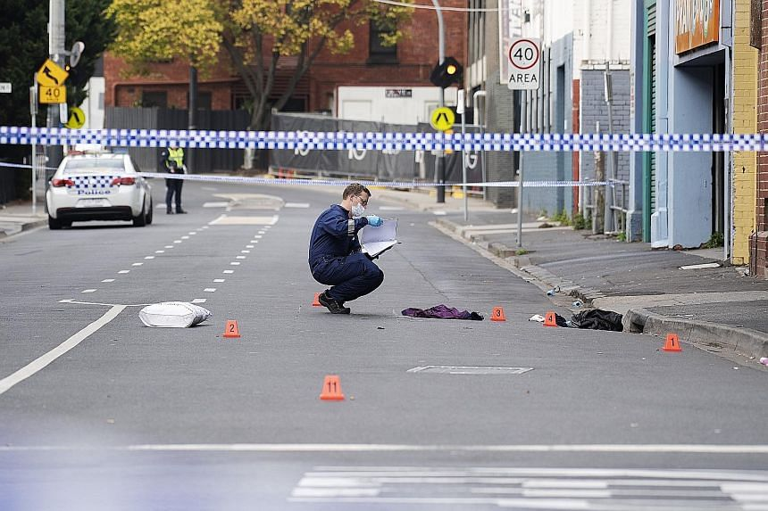 Police officers at the scene yesterday of the shooting outside the Love Machine nightclub in Melbourne's south-eastern suburb of Prahran that killed a security guard and wounded three others. There was no suggestion yet that the attack was terror-rel