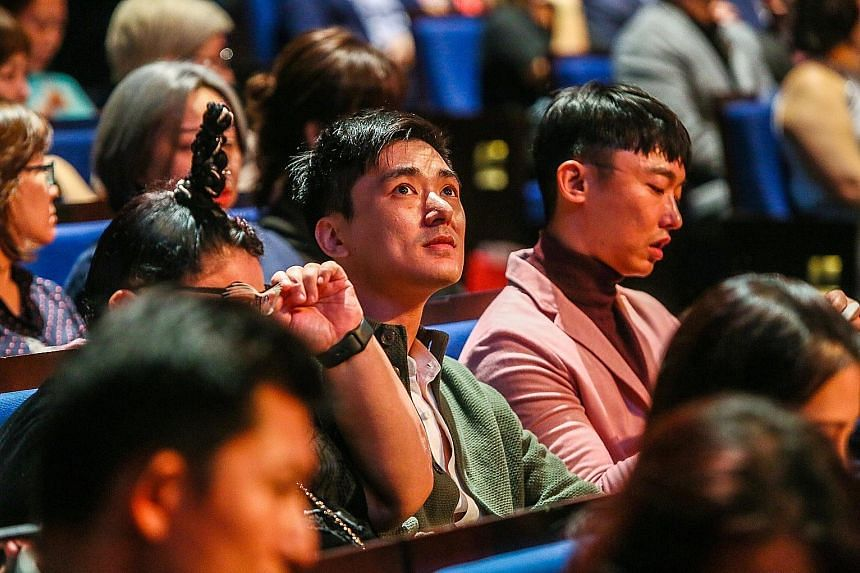 Siblings Kenny (centre) and Jefferson Pang, brothers of the late Aloysius Pang, at the awards. A video was played in tribute to the late actor. Chen Hanwei and Zoe Tay, winners of the Best Actor and Best Actress awards. They played a married couple i