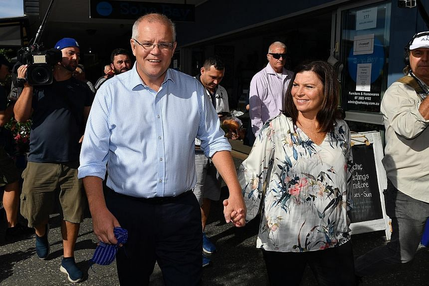 Australian Prime Minister Scott Morrison and his wife, Jenny, on a walk at the Redcliffe Jetty Markets in Brisbane yesterday. In announcing the May 18 election last Thursday, he listed various reasons why he believed Australians should vote for him,