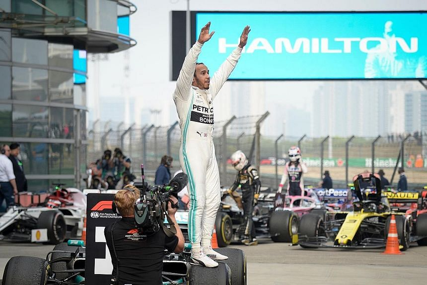 Lewis Hamilton celebrating after winning the Formula One Chinese Grand Prix in Shanghai yesterday. His sixth China win and 75th overall gave him a six-point lead over teammate Valtteri Bottas. He is 31 points ahead of Ferrari's Sebastian Vettel.