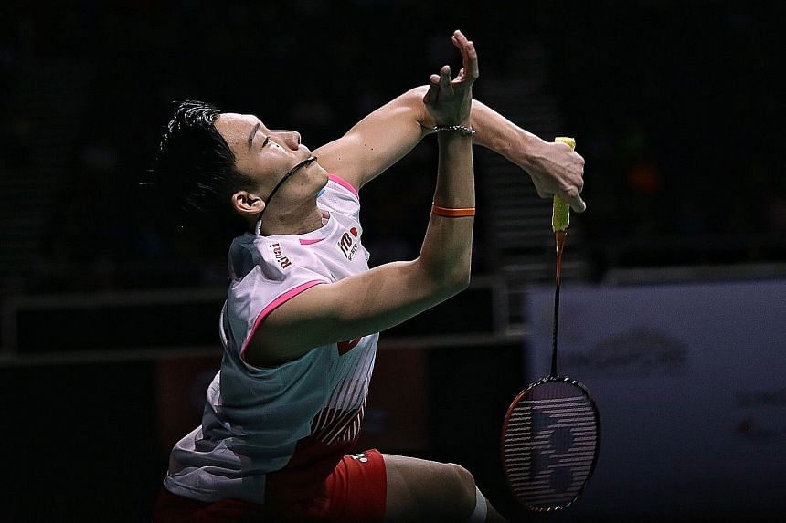 Japan's Kento Momota showing his true grit in staging a comeback win over Anthony Ginting of Indonesia in the Singapore Badminton Open men's singles final yesterday.