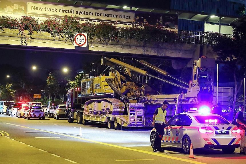 The scene of an accident where a crane collided with the underside of an overhead bridge across Jurong Town Hall Road on Saturday night. At 10.20pm, the Land Transport Authority tweeted that an accident had occurred in Jurong Town Hall Road towards S