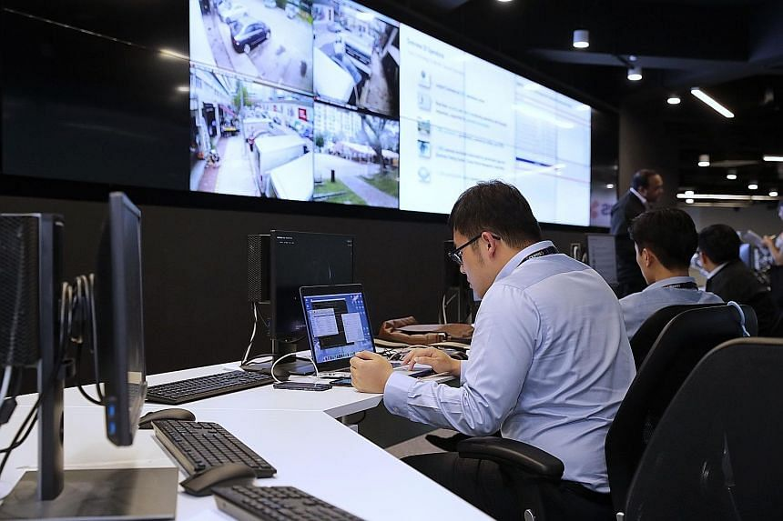 Digital technology being applied at the Certis Integrated Operations Centre, where staff can monitor many different areas without having to deploy employees on-site. Such technology capabilities can boost productivity as well as address the manpower