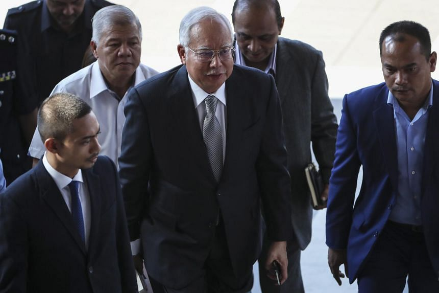 Former Malaysian prime minister Najib Razak (centre) arriving at the High Court in Kuala Lumpur, on April 15, 2019.