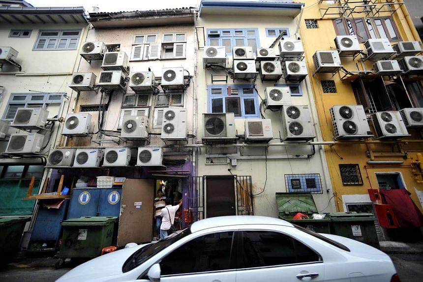 Air conditioning compressors on the back of a building in Boat Quay.