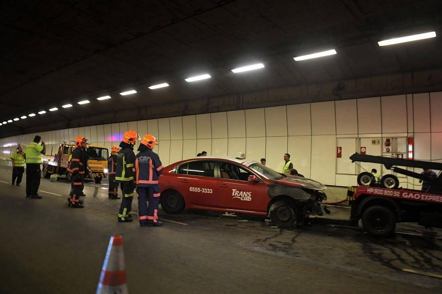 SCDF officers at the scene after a taxi caught fire in Kallang-Paya Lebar expressway tunnel, on Aug 29, 2017.