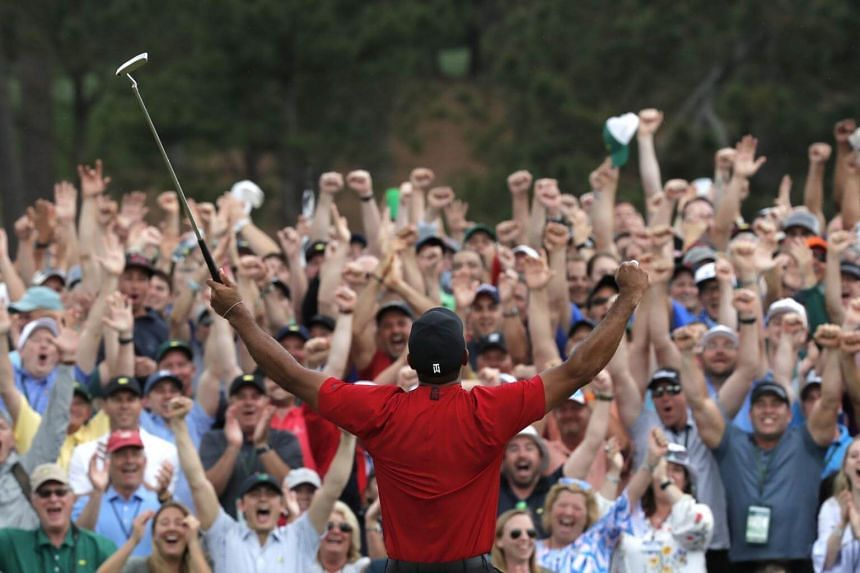 Tiger Woods celebrates on the 18th hole after winning the 2019 Masters.