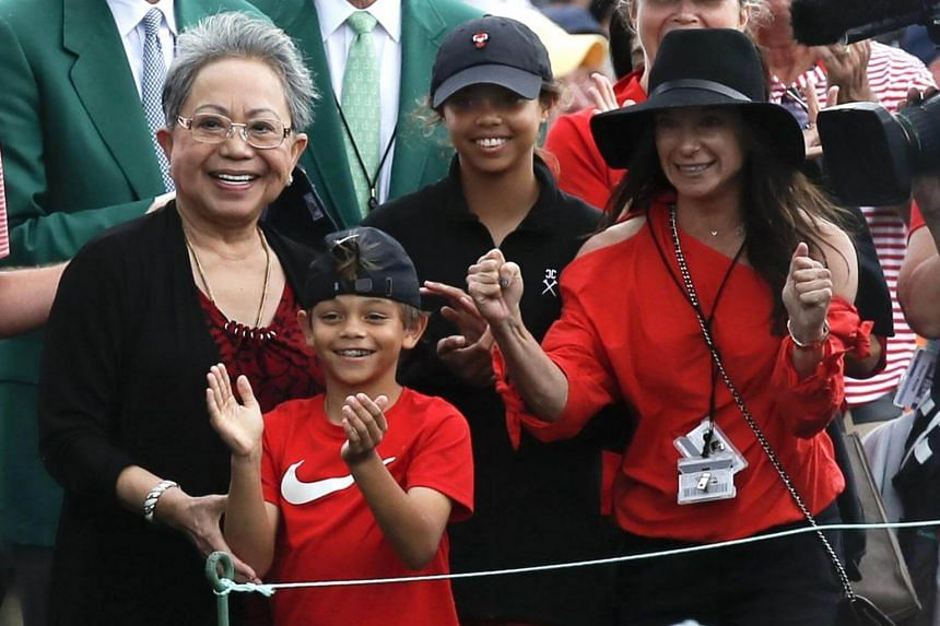 Tiger Woods' daughter Sam Alexis, son Charlie Axel, mother Kultida woods (left) and girlfriend Erica Herman, smile as he approaches them after winning the 2019 Masters.