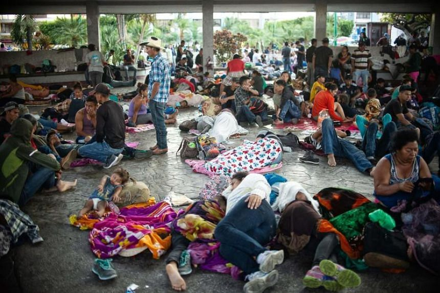 Central American migrants heading in caravan to the US rest during a stop in their journey, at park Hidalgo in Tapachula, Chiapas state, Mexico, on April 13, 2019.