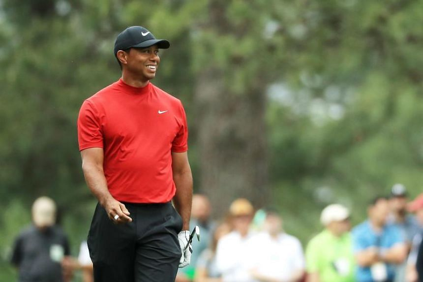 Tiger Woods of the United States reacts on the ninth hole during the final round of the Masters at Augusta National Golf Club in Augusta, Georgia, on April 14, 2019.