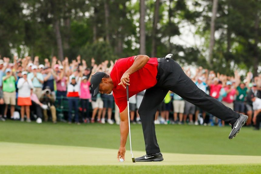 Woods after sinking his putt on the 18th green to win the Masters.