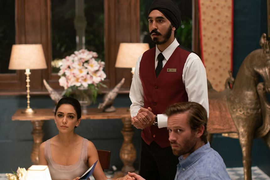 Dev Patel (centre), with Nazanin Boniadi and Armie Hammer, play characters trapped inside a luxury hotel that has been taken over by militant Islamic terrorists.