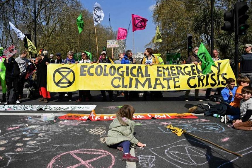 Environmental protesters from the Extinction Rebellion group stage a demonstration at a road near Marble Arch in London on April 15, 2019.