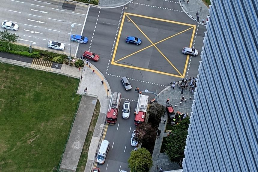 In an overhead photo provided to The Straits Times, at least two SCDF vehicles can be seen while several passers-by surround the scene of the accident.
