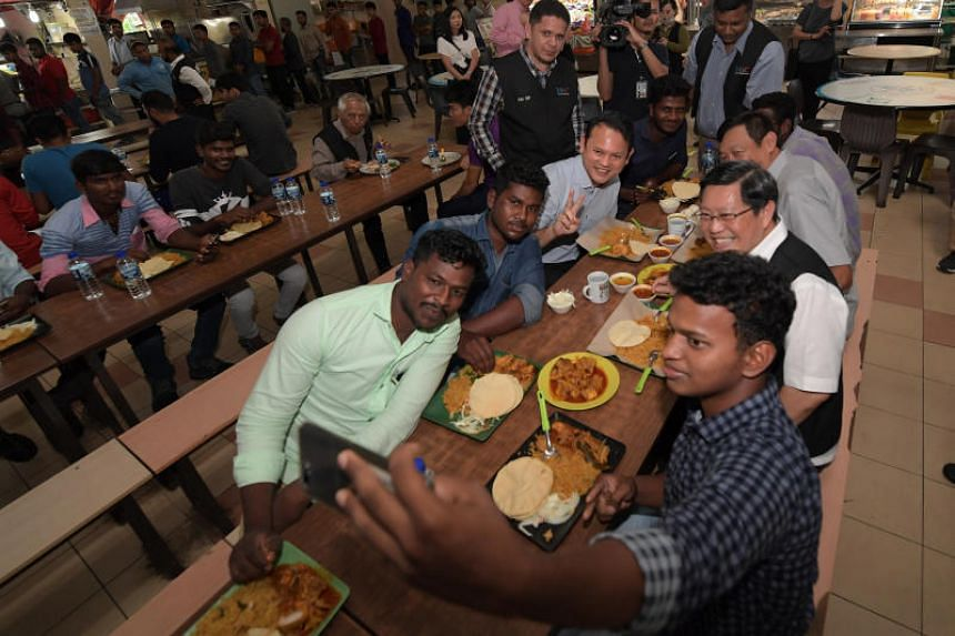 Minister of State for Manpower Zaqy Mohamad (third, left) said 90 per cent of employers have backed the Settling-In Programme, despite it costing them a $75 fee for each employee.