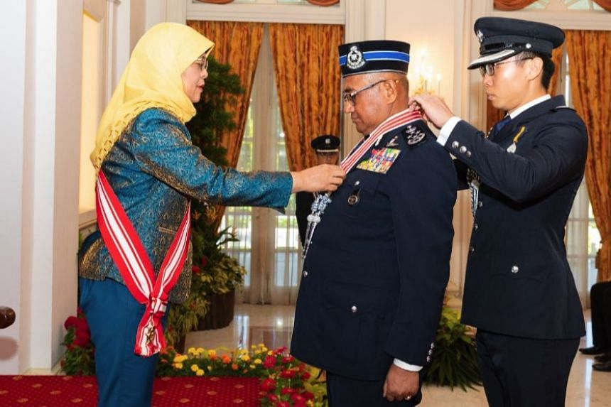 President Halimah Yacob conferred the Distinguished Service Order on Malaysia's Inspector-General of Police Mohamad Fuzi Harun at the Istana State Room on April 15, 2019.